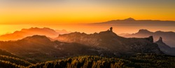 Sunset from the top of Gran Canaria Island. Pico de las Nieves. As main subject you can see the Roque nublo and the Teide in Tenerife Island.