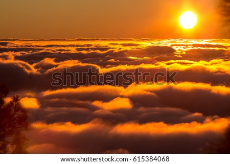 Sunset from the  top of mountain over the clouds - Shutterstock ID 615384068