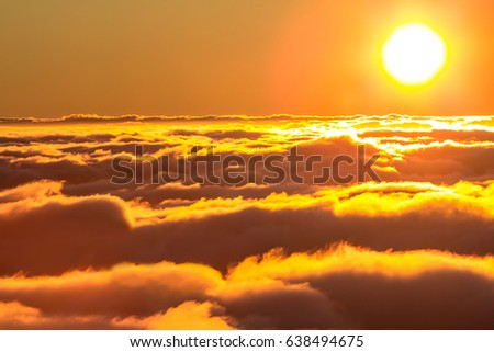 Sunset from the  top of mountain over the clouds - Shutterstock ID 638494675