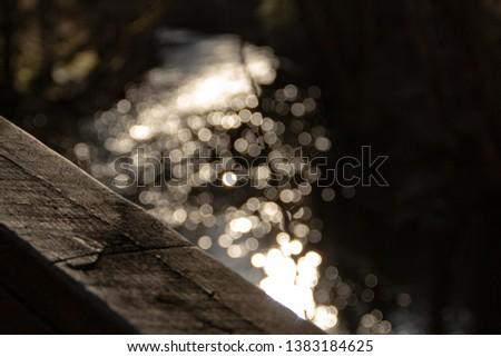 Sunset glistening on water on walkpath