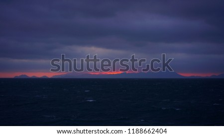 Stock Photo Sunset glow and thick cloud over the horizon of southern sea of Korea seen from passenger ship from Jejudo to Wando