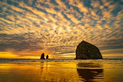 sunset image of Haystack Rock and the Needles at Canon Beach on the north Oregon coast