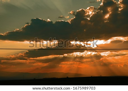 Sunset in a cloudy day Stok fotoğraf ©
