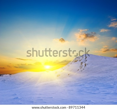 sunset in a winter snowbound hills