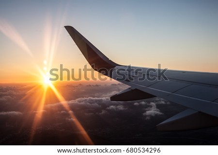 Sunset in airplane with wing