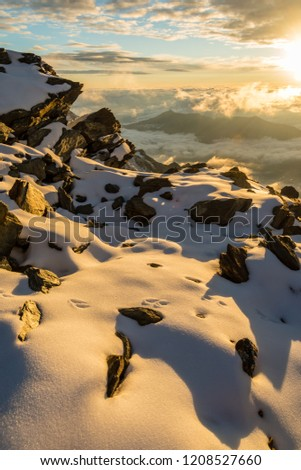 Sunset in alpin mountains near Aiguille de Bionnassay peak, Mont Blanc massif, France