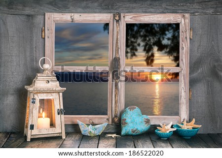 Sunset in autumn - cozy atmosphere with a candle at home.