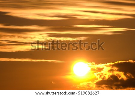sunset in autumn in November, a bright yellow, brown and black, round the sun in the sky, clouds heavy different sizes,  - Shutterstock ID 519082627