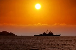 Sunset in Benidorm with battleship