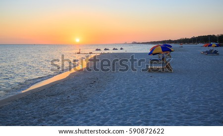 Sunset in Biloxi beach, Mississippi, along Gulf Coast shore