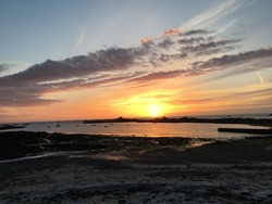 Sunset in Cobo bay on channel island of Guernsey in England