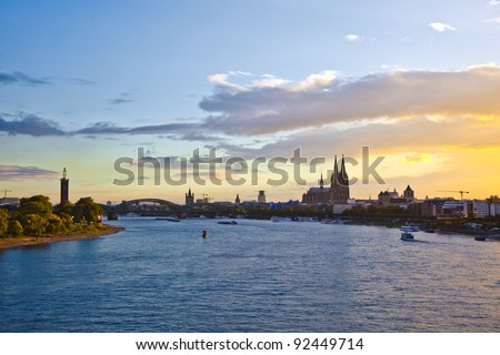 sunset in cologne with Dome and river Rhine - stock photo