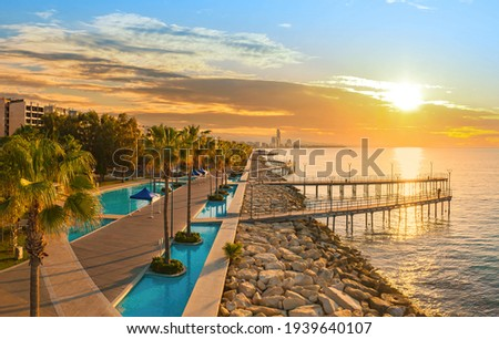 Sunset in Cyprus Limassol. Panorama of  Cyprus Limassol resort. Limassol promenade at sunset. Cyprus resort on sunset background. Tourist places on Mediterranean coast.
