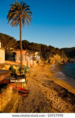 Sunset in Forno Beach, in the bay of Biodola, Isle of Elba, Livorno, Italy.