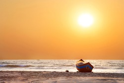 Sunset in Goa. Yellow sunset and boat and sea shore