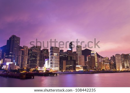 Sunset in Hong Kong with office buildings background