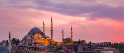 Sunset in Istanbul, Turkey with Suleymaniye Mosque (Ottoman imperial mosque). View from Galata Bridge in Istanbul. TURKEY