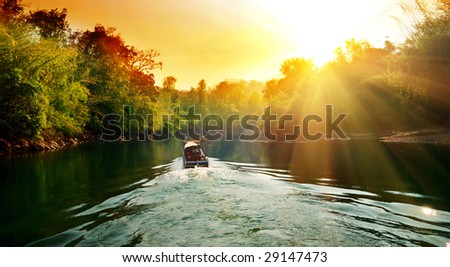 sunset in jungle and boat