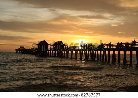 Sunset in Naples pier on beach Golf of Mexico, Florida