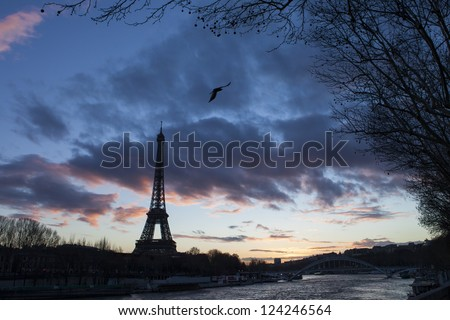Sunset in Paris with Eiffel Tower with red clouds and blue sky