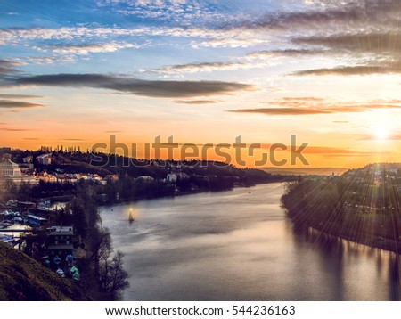 Sunset in Prague, view from Vishegrad on the river Vltava, Czech Republic.Beautiful sunset in Prague(Praha) at autumn time and red tile roofs around.View on historical old buildings and Castle - Shutterstock ID 544236163