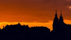 Sunset in Prague with silhouette of the church