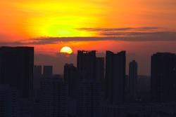 Sunset in Singapore with highrise buildings