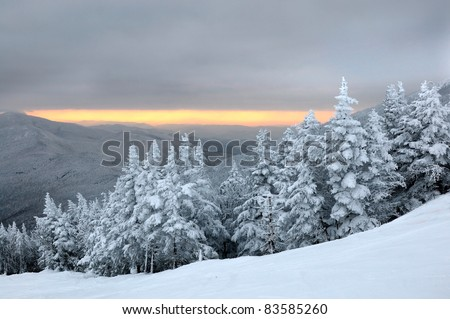 Sunset in ski resort mountains Stowe, VT - stock photo