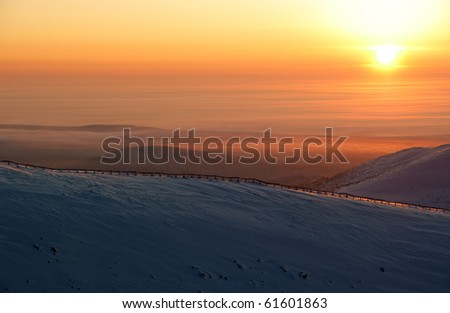 sunset in snow-covered mountains