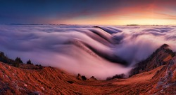 Sunset in the autumn mountains above the clouds during the weather inversion Fatra mountains in Slovakia, beautiful landscape