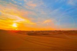 Sunset in the beautiful sand dunes of Dubai, UAE