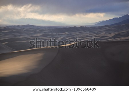 Sunset in the desert. Photo of the Colorado sand dunes at sunset.  #1396568489