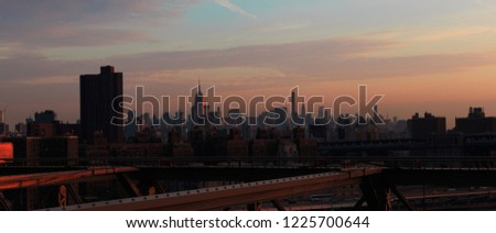 Sunset in the empire street in New York from Brooklyn bridge #1225700644