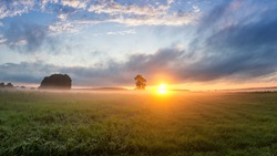 sunset in the field with fog, Russia, the Urals,