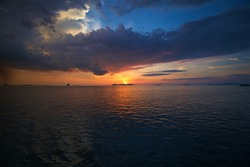 sunset in the Gulf of Thailand, islands near Surat Thani, thunderclouds in the sky, sea landscape, background for wallpaper and walls