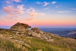 Sunset in the Harz mountains on Mount Brocken, Harz National Park, Saxony-Anhalt, Germany. Fabled granite rock formations called Teufelskanzel and Hexenaltar.