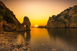 Sunset in the mediterranean. A beautiful rocky beach at sunset. Kas, Antalya, Turkey.