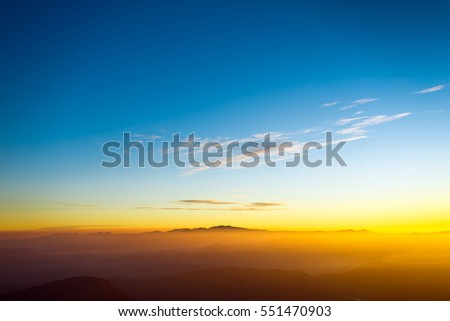 Sunset in the mountain landscape. Young freedom on mountain peak. #551470903