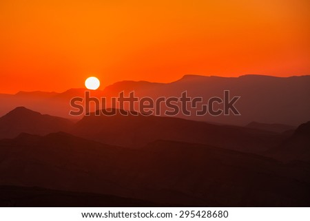 Sunset in the mountains in the desert Negev #295428680