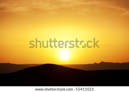 Sunset in the Sahara desert. Concept of holiday and traveling.