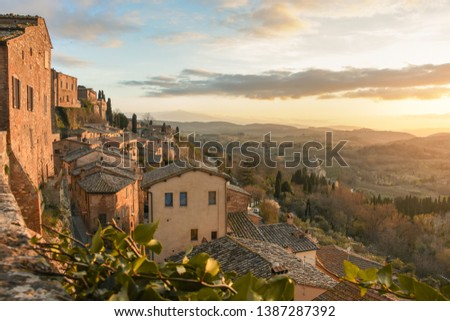Sunset in Tuscany town in Italy #1387287392