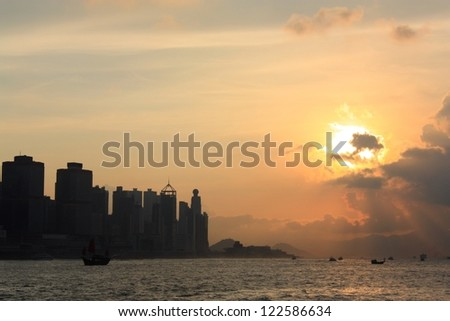 Sunset in Victoria Harbor, silhouette of Hong Kong.
