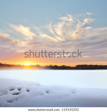 Sunset in winter. Winter landscape.