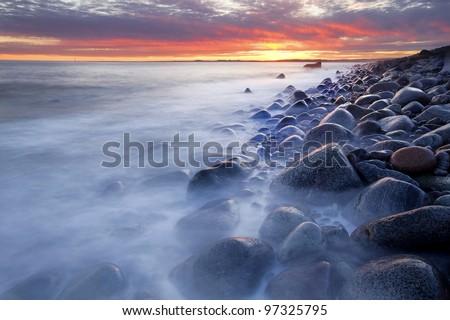 Sunset in wintertime at the Norwegian coast, Moelen - stock photo
