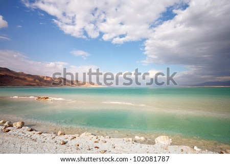 Sunset. Incredible lighting effects on the Dead Sea in Israel. Clouds are reflected in the sea