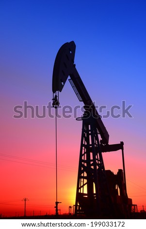 Sunset is a job of the pumping unit in oil field