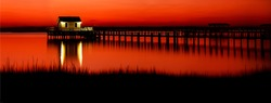 Sunset lake house pier panorama. Red sunset lake house panorama. Panorama of sunset red lake house. Sunset red water panorama
