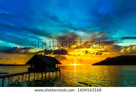 Sunset lake house silhouette view. Lake house sunset silhouette. Sunset lake house scene. Sunset lake house landscape