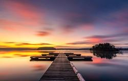 Sunset lake pier landscape view