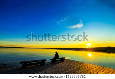 Photo of  Sunset lake pier silhouette landscape. Sunset lake pier landscape. Sunset lake pier silhouette view. Sunset lake pier view